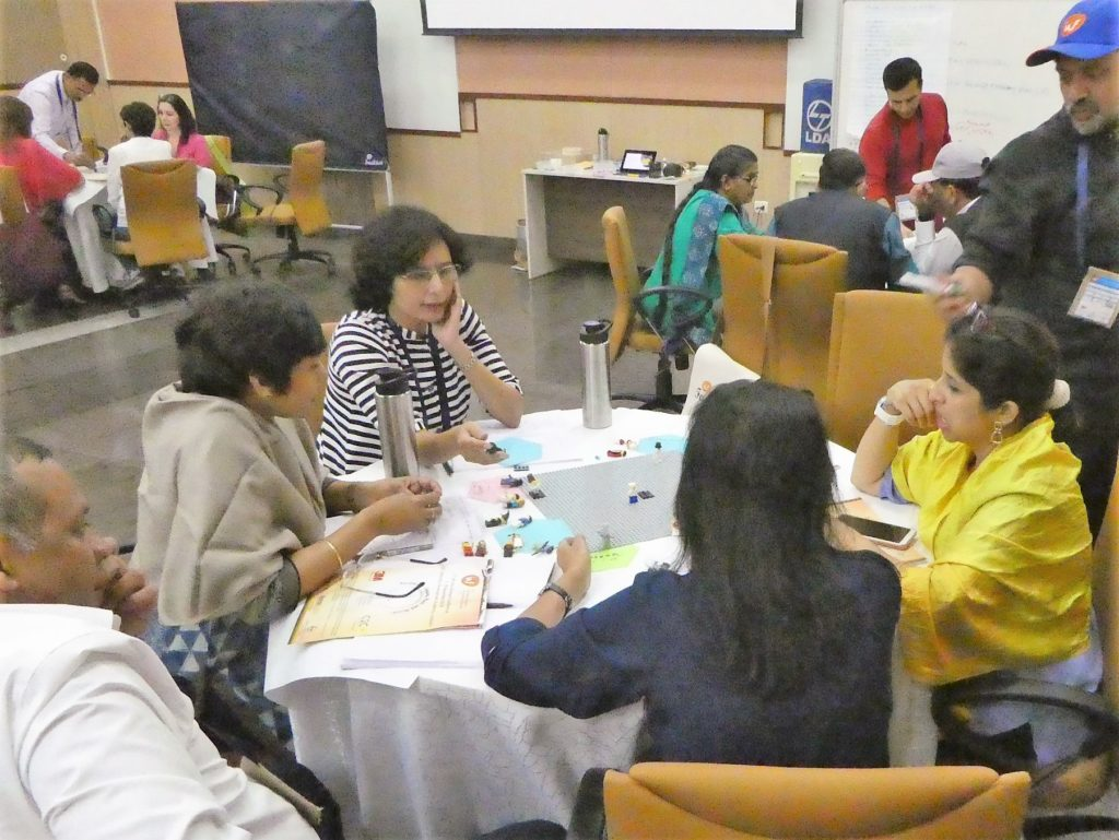 Participants at the IAF India Conference 2018 working with each other to figure out the meaning of facilitation.